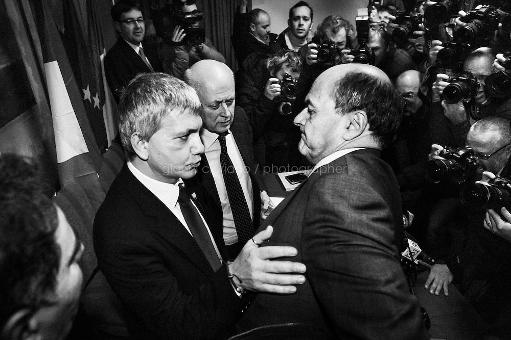 """Nichi Vendola (leader of the """"Left Ecology Freedom"""" party and LGBT activist) touches Pierluigi Bersani (Democratic Party leader running for Prime Minister), after giving a press conference together with Bruno Tabacci (center, Democratic Center) in which the leaders agreed to run in the same centre-left coalition for the 2013 general election, in Rome, Italy, on January 24th, 2013.<br /> <br /> Pierluigi Bersani, running for Prime Minister in the 2013 elections in Italy, said he wouldn't dump his ally Nichi Vendola for former PM Mario Monti. <br /> <br /> A general election to determine the 630 members of the Chamber of Deputies and the 315 elective members of the Senate, the two houses of the Italian parliament, took place on 24–25 February 2013. The main candidates running for Prime Minister are Pierluigi Bersani (leader of the centre-left coalition """"Italy. Common Good""""), former PM Mario Monti (leader of the centrist coalition """"With Monti for Italy"""") and former PM Silvio Berlusconi (leader of the centre-right coalition).<br /> <br /> ###<br /> <br /> ROMA, ITALIA - 24 GENNAIO 2013: Nichi Vendola (leader della lista """"Sinistra Ecologia Libertà"""" e attivista LGBT) tocca Pierluigi Bersani (PD - Partito Democratico, leader candidate alla Presidenza del Consiglio dopo una conferenza stampa presieduta insieme a Bruno Tabacci (centro, Centro Democratico)  al Residence Ripetta a Roma, il 24 gennaio 2013. Le elezioni politiche italiane del 2013 per il rinnovo dei due rami del Parlamento italiano – la Camera dei deputati e il Senato della Repubblica – si terranno domenica 24 e lunedì 25 febbraio 2013 a seguito dello scioglimento anticipato delle Camere avvenuto il 22 dicembre 2012, quattro mesi prima della conclusione naturale della XVI Legislatura. I principali candidate per la Presidenza del Consiglio soon Pierluigi Bersani (leader della coalizione di centro-sinistra """"Italia. Bene Comune""""), il premier uscente Mario Monti (leader della coalizione di centro """"Con Monti per l'It"""