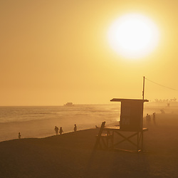 Lifeguard Tower M sunset photo in Newport Beach, CA. Newport Beach is a popular beach city in Orange County Southern California i n the Western United States of America. Photo is Copyright ⓒ 2017 Paul Velgos with All Rights Reserved.