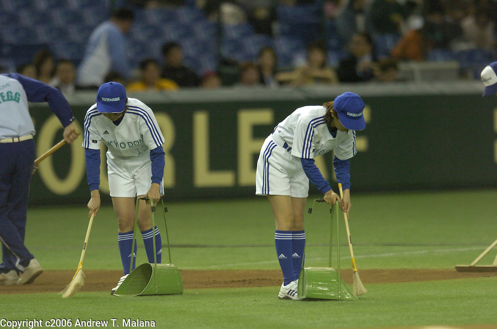 Tokyo Dome field crew sweeps the infield turf before the start of the second game of the World Baseball Classic matching up Team Japan and Team China at Tokyo Dome, Tokyo, Japan.
