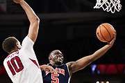 FAYETTEVILLE, AR - FEBRUARY 27:  Mustapha Heron #5 of the Auburn Tigers goes in for a layup past Daniel Gafford #10 of the Arkansas Razorbacks at Bud Walton Arena on February 27, 2018 in Fayetteville, Arkansas.  The Razorbacks defeated the Tigers 91-82.  (Photo by Wesley Hitt/Getty Images) *** Local Caption *** Mustapha Heron; Daniel Gafford