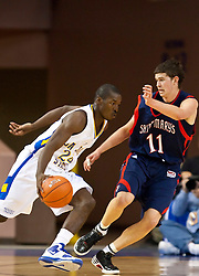 November 30, 2009; San Jose, CA, USA;  San Jose State Spartans guard Chris Jones (24) dribbles past Saint Mary's Gaels forward Clint Steindl (11) during the first half at the Event Center Arena.  Saint Mary's defeated San Jose State 78-71.