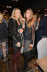 Left to right, ADELA KING, her dog Disco and SOPHIE STANBURY at a party to celebrate the publication of Flourish by Willow Crossley held at OKA, 155-167 Fulham Rd, London on 4th October 2016.