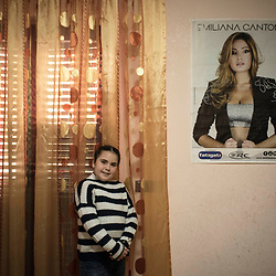 Elena Alvetta, 8 years old, poses inside her room in Afragola. She is a great fan of Emiliana Cantone.