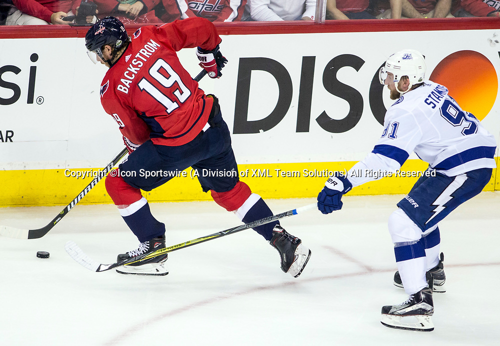 WASHINGTON, DC - MAY 21: Washington Capitals center Nicklas Backstrom (19) turns the puck away from Tampa Bay Lightning center Steven Stamkos (91) during game 6 of the NHL Eastern Conference  Finals between the Washington Capitals and the Tampa Bay Lightning, on May 21, 2018, at Capital One Arena, in Washington D.C. The Caps defeated the Lightning 3-0<br /> (Photo by Tony Quinn/Icon Sportswire)