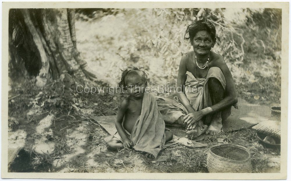 Veddah woman and Child. signed R. L. Spittel, Colombo on the back of the print.