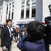 A Japanese film crew work outside Yankee Stadium before the New York Yankees Vs Toronto Blue Jays season opening day at Yankee Stadium, The Bronx, New York. 6th April 2015. Photo Tim Clayton