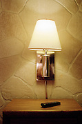 Silver lamp attached to a faux stone wall