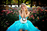 Soccer enthusiast taking her senior picture in her blue prom dress.