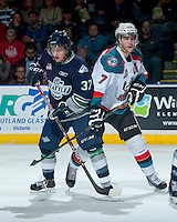 KELOWNA, CANADA - APRIL 3: Russell Maxwell #37 of the Seattle Thunderbirds checks Damon Severson #7 of the Kelowna Rockets on April 3, 2014 during Game 1 of the second round of WHL Playoffs at Prospera Place in Kelowna, British Columbia, Canada.   (Photo by Marissa Baecker/Getty Images)  *** Local Caption *** Russell Maxwell; Damon Severson;