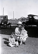 woman posing with two boys USA 1920s
