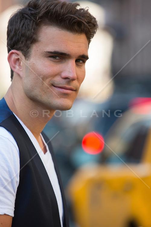 portrait of a handsome twenty year old man in New York City
