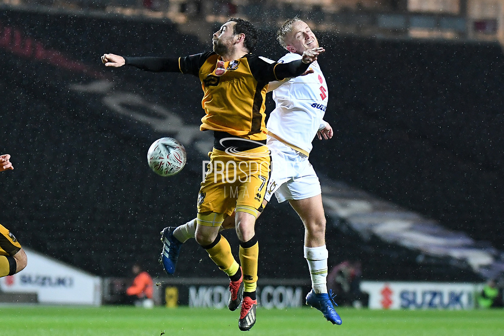 Milton Keynes Dons midfielder Ben Reeves (7)  battles for possession  with Port Vale midfielder David Worrall (7) during the The FA Cup match between Milton Keynes Dons and Port Vale at stadium:mk, Milton Keynes, England on 9 November 2019.