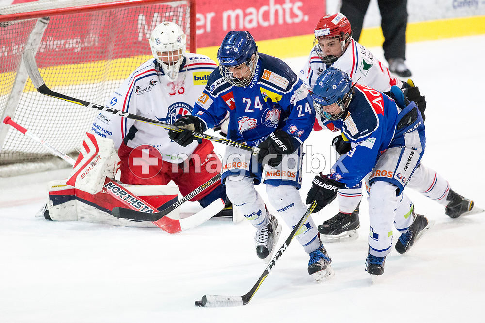 (L-R) Rapperswil-Jona Lakers goaltender Beat Trudel, ZSC Lions forward Noah Zimmermann, Dimitry Mokry and Rapperswil-Jona Lakers defenseman Antoine Janssen battle for possession during the fourth Elite B Playoff Final ice hockey game between ZSC Lions and Rapperswil-Jona Lakers in Duebendorf, Switzerland, Friday, Mar. 17, 2017. (Photo by Patrick B. Kraemer / MAGICPBK)