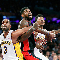 08 December 2013: Toronto Raptors power forward Amir Johnson (15) vies for the rebound with Los Angeles Lakers power forward Shawne Williams (3) and Los Angeles Lakers small forward Nick Young (0) during the Toronto Raptors 106-94 victory over the Los Angeles Lakers at the Staples Center, Los Angeles, California, USA.