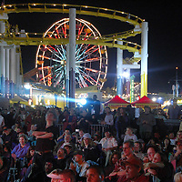 People listen to 'The Ventures' perform during the kick-off of the 23rd Annual Twilight Dance Series at the Santa Monica Pier on Thursday, June 28, 2007.