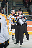 KELOWNA, CANADA - OCTOBER 25: Mike Campbell, referee makes a call against the Brandon Wheat Kings on October 25, 2014 at Prospera Place in Kelowna, British Columbia, Canada.  (Photo by Marissa Baecker/Shoot the Breeze)  *** Local Caption *** Mike Campbell; referee;