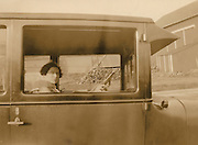 A woman sitting in here car