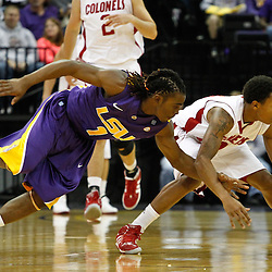 November 12, 2011; Baton Rouge, LA; LSU Tigers guard Anthony Hickey (1) reaches in against Nicholls State Colonels guard Dantrell Thomas (1) during the first half of a game at the Pete Maravich Assembly Center.  Mandatory Credit: Derick E. Hingle-US PRESSWIRE