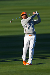 Feb 8, 2012; Pebble Beach CA, USA;  Rickie Fowler hits his second shot on the first hole during the practice round of the AT&T Pebble Beach Pro-Am at Pebble Beach Golf Links. Mandatory Credit: Jason O. Watson-US PRESSWIRE