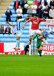 Bristol City's Derrick Williams battles for the high ball with Coventry City's Simeon Jackson  - Photo mandatory by-line: Joe Meredith/JMP - Mobile: 07966 386802 - 18/10/2014 - SPORT - Football - Coventry - Ricoh Arena - Bristol City v Coventry City - Sky Bet League One