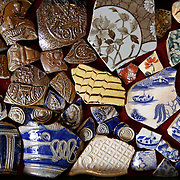 A variety of ceramic objects which have been excavated from the River Thames by mudlarker Jason Sandy are displayed in his home in London, Britain June 01, 2016. When the river Thames is at low tide, mudlarkers scour the shore for historical artefacts and remains from there City of London's ancient past. Finds can date back to Roman times to when the city was found up until more recent times. Anyone can walk along the river and look for finds, but the uses of metal detectors and digging is restricted. Mudlarkers need to be licences by the Port of London Authority. All find should be register with the Museum of London. REUTERS/Neil Hall