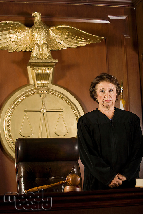 Female mature judge in a courtroom