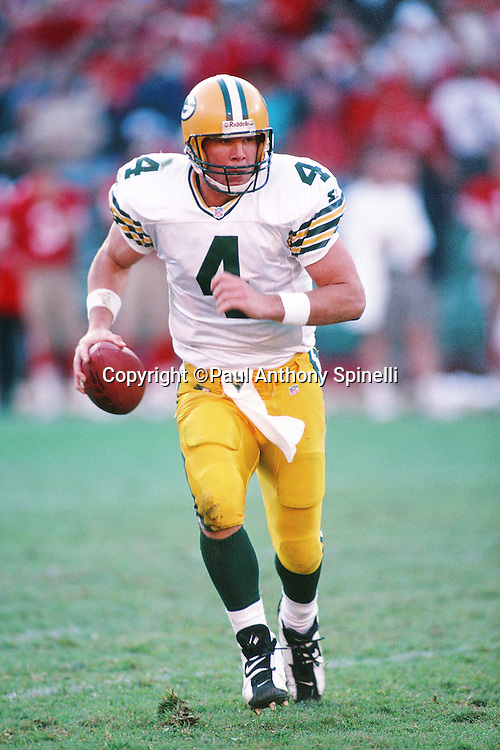 Green Bay Packers quarterback Brett Favre (4) runs the ball during the NFL NFC Divisional Playoff football game against the San Francisco 49ers on Jan. 6, 1996 in San Francisco. The Packers won the game 27-17. (©Paul Anthony Spinelli)