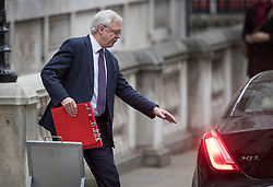 © Licensed to London News Pictures. 06/12/2017. London, UK. Brexit Secretary David Davis leaves his office in Downing Street carrying his red ministerial folder to appear before the House of Commons Brexit Committee. Photo credit: Peter Macdiarmid/LNP