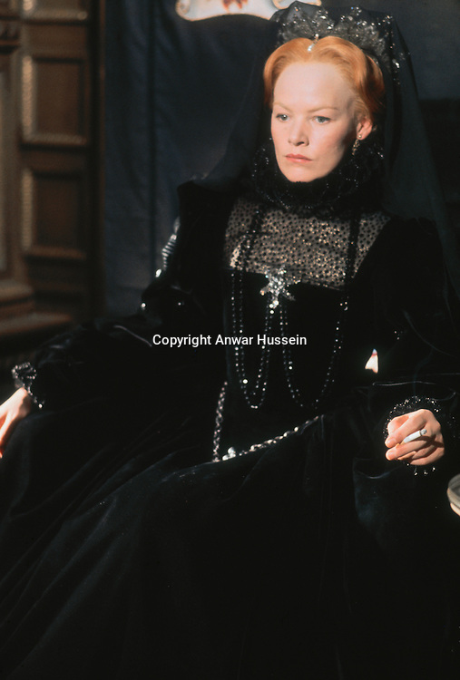 English actress Glenda Jackson stars as Queen Elizabeth I in the television miniseries 'Elizabeth R', 1971. A cigarette adds an incongruous touch to her period ensemble.
