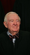 Justice John Paul Stevens participates in the formal press photograph of the Justices of the United States Supreme Court in Washington, DC on March 3,2006.  Photograph: Dennis Brack