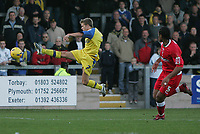 Photo: Lee Earle.<br /> Torquay United v Swindon Town. Coca Cola League 2. 18/11/2006. Swindon's Jerel Ifil (R) watches as Torquay's Jamie Ward tries a shot on goal.