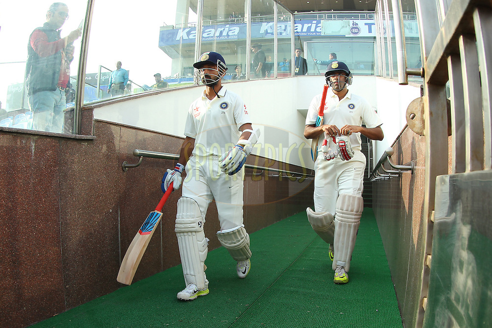 Ajinkya Rahane of India and Ravichandran Ashwin of India come out to bat during day two of the 4th Paytm Freedom Trophy Series Test Match between India and South Africa held at the Feroz Shah Kotla Stadium in Delhi, India on the 4th December 2015<br /> <br /> Photo by Ron Gaunt  / BCCI / SPORTZPICS