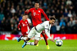 Dele Alli of Tottenham Hotspur is challenged by Corentin Tolisso of Bayern Munich - Rogan/JMP - 01/10/2019 - FOOTBALL - Tottenham Hotspur Stadium - London, England - Tottenham Hotspur v Bayern Munich - UEFA Champions League Group B.