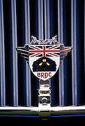 BRDC car badge, British Racing Drivers Club, on restored vintage car at Ashton Keynes Vintage Restorations in Wiltshire, UK