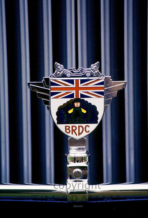 BRDC car badge, British Racing Drivers Club, on restored vintage car at Ashton Keynes Vintage Restorations in Wiltshire, UK