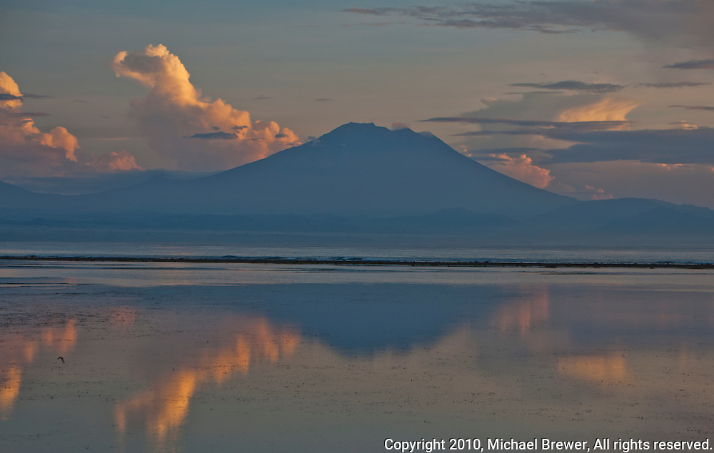 Mt. Agung seen reflecting in the ocean at dawn from Sanur Beach in Bali, Indonesia