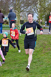 © Licensed to London News Pictures.  23/03/2014. OXFORD, UK. Prime minister DAVID CAMERON (centre) at the end of the Oxford Sport Relief Mile. Photo credit: Cliff Hide/LNP