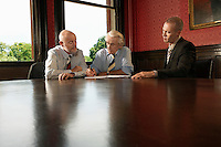 Two Older Men and One Younger Man in Meeting