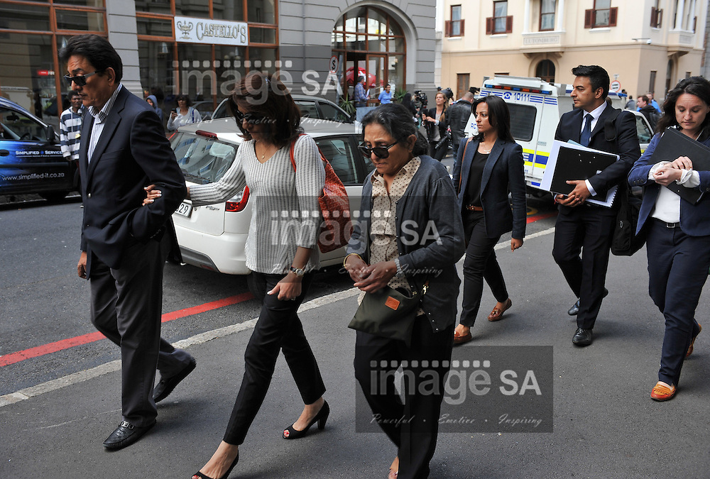 CAPE TOWN, SOUTH AFRICA - Wednesday 8 October 2014, family of Shrien Dewani leave court after the day's proceedings during Day 2 of the Shrien Dewani trial at the Cape High Court before Judge Jeanette Traverso. Dewani is caused of hiring hit men to murder his wife, Anni. Anni Ninna Dewani (n&eacute;e Hindocha; 12 March 1982 &ndash; 13 November 2010) was a Swedish woman who, while on her honeymoon in South Africa, was kidnapped and then murdered in Gugulethu township near Cape Town on 13 November 2010 (wikipedia).<br /> Photo by Roger Sedres