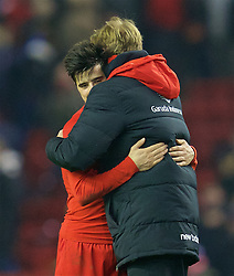 LIVERPOOL, ENGLAND - Wednesday, January 20, 2016: Liverpool's manager Jürgen Klopp hugs goal-scorer Joao Carlos Teixeira after the 3-0 victory over Exeter City during the FA Cup 3rd Round Replay match at Anfield. (Pic by David Rawcliffe/Propaganda)