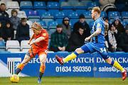 Gillingham defender Connor Ogilvie (34) tried to block Gillingham midfielder Bradley Stevenson (25) during the EFL Sky Bet League 1 match between Gillingham and Wycombe Wanderers at the MEMS Priestfield Stadium, Gillingham, England on 15 December 2018.