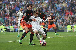 April 29, 2017 - Madrid, Spain - MADRID, SPAIN. APRIL 29th, 2017 - Parejo fouls Luca Modric which became a penalty kick. La Liga Santander matchday 35 game. Real Madrid defeated 2-1 Valencia with goals scored by Cristiano Ronaldo (26th minute) and Marcelo (86th minute). Parejo (82nd minute) scored for Valencia. Santiago Bernabeu Stadium. Photo by Antonio Pozo | PHOTO MEDIA EXPRESS (Credit Image: © Antonio Pozo/VW Pics via ZUMA Wire/ZUMAPRESS.com)