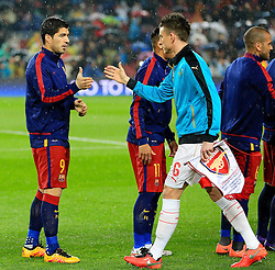 Luis Suarez of Barcelona shakes hands with Arsenal's Laurent Koscielny  - Mandatory byline: Matt McNulty/JMP - 16/03/2016 - FOOTBALL - Nou Camp - Barcelona,  - FC Barcelona v Arsenal - Champions League - Round of 16