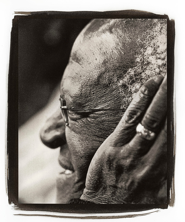 A portrait of Desmond Tutu smiling with his hand to his head while waiting for breakfast in a Cape Town diner. Desmond Mpilo Tutu (born 7 October 1931) is a South African cleric and activist who rose to worldwide fame during the 1980s as an opponent of apartheid. In 1984, Tutu became the second South African to be awarded the Nobel Peace Prize. Tutu was elected and ordained the first black South African Anglican Archbishop of Cape Town, South Africa, and primate of the Church of the Province of Southern Africa (now the Anglican Church of Southern Africa). Tutu chaired the Truth and Reconciliation Commission and is currently the chairman of The Elders. Tutu is vocal in his defence of human rights and uses his high profile to campaign for the oppressed. Tutu also campaigns to fight AIDS, poverty and racism. He received the Nobel Peace Prize in 1984, the Albert Schweitzer Prize for Humanitarianism, and the Gandhi Peace Prize in 2007.