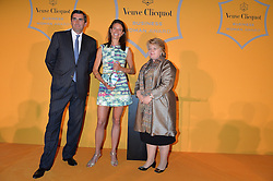 Left to right, JEAN-MARC GALLOT, EMILY BROOKE winner of the Veuve Clicquot New Generation Award and HEATHER McGREGOR at the Veuve Clicquot Business Woman Awards held at Claridge's, Brook Street, London on 11th May 2015.
