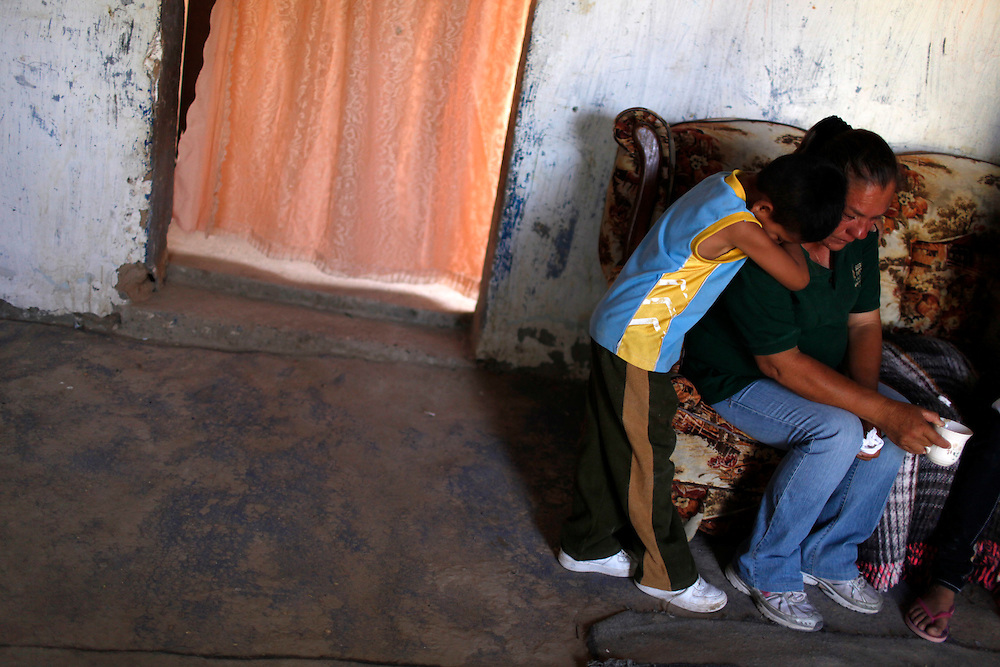From right, the mother Maria Guadalupe Guereca is comforted by her nephew Kevin Jahel Jimenez Hernandez as they mourn the death of Sergio Adrian Hernandez Guereca, who was killed yesterday by a Border Patrol agent.