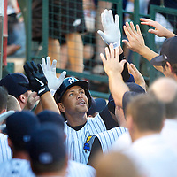 New York Yankees Third Baseman Alex Rodriguez is congratulated by his teammates in the dugout after homering in his second at bat during a rehab minor league game for the AA Trenton Thunder in Trenton, NJ on August 2, 2013.  He is facing a suspension by Major League Baseball for his use of steroids with the Biogenesis clinic in Florida.