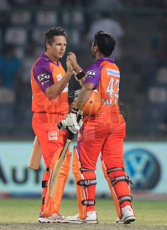 Kochi Tuskers Kerala player Parthiv Patel and Kochi Tuskers Kerala player Brad Hodge celebrates after the victory during match 41 of the Indian Premier League ( IPL ) Season 4 between the Delhi Daredevils and the Kochi Tuskers Kerala held at the Feroz Shah Kotla Stadium in Delhi, India on the 2nd May 2011..Photo by Pankaj Nangia/BCCI/SPORTZPICS