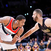 21 March 2014: Los Angeles Lakers guard Kendall Marshall (12) defends on Washington Wizards forward Trevor Ariza (1) during the Washington Wizards 117-107 victory over the Los Angeles Lakers at the Staples Center, Los Angeles, California, USA.