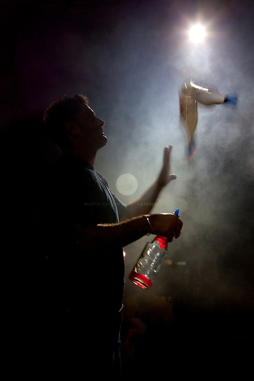 Nightlife in Dubai: ASIA, UNITED ARAB EMIRATES, DUBAI, 25.09.2009. A bartender performs a freestyle session during a competition with other UAE bartenders.